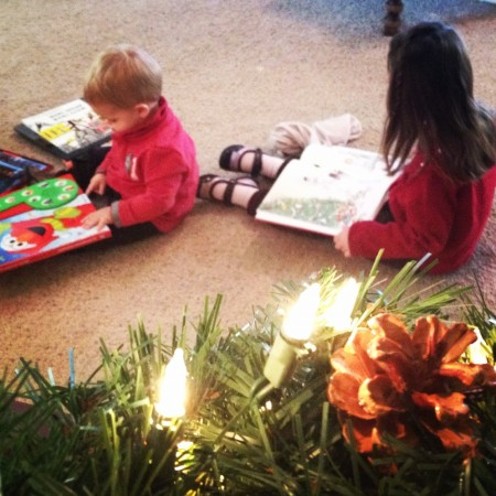 kids reading Christmas books, holiday traditions