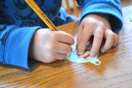 child holding pencil, crafting, holidays, moms