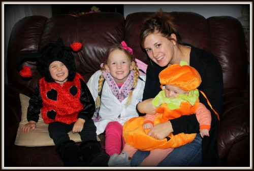 young mom with kids, halloween, costumes