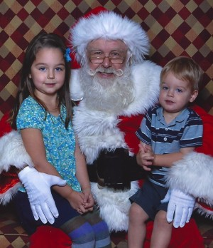 girl and boy, sitting on santa's lap, mall santa