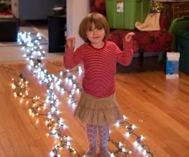 clara with christmas lights