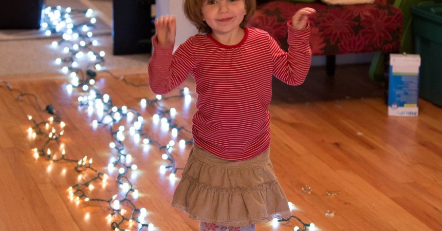 clara with christmas lights
