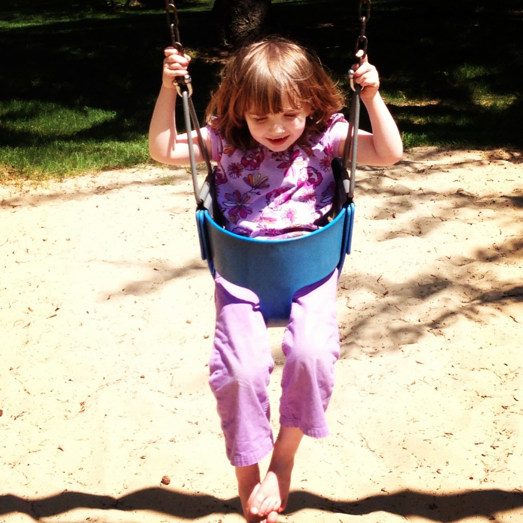 clara-on-swings